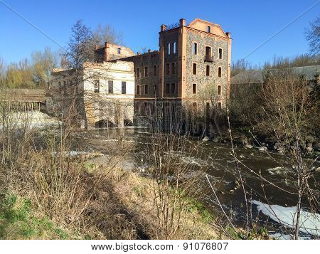 Old abandoned dam, a strong flow of water