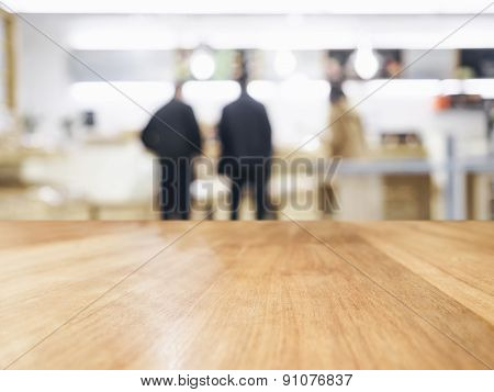 Table Top With Blurred People In Shop Interior Background