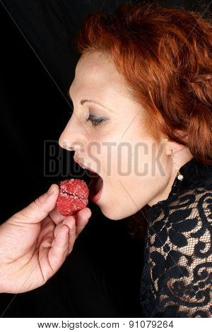 Red Hair Woman About To Bite Pastry