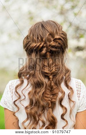 Girl with beautiful  braid hairstyle, rear view