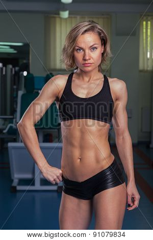 Sexy, blonde, doing fitness in the gym.
