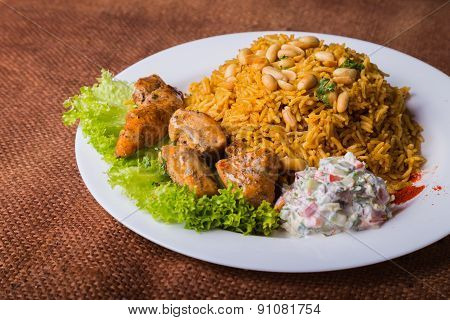Appetizing, delicious pilaf with meat on a plate.