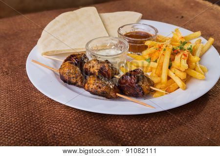 Kebab with potatoes. Skewers. Skewers of meat. Eastern food