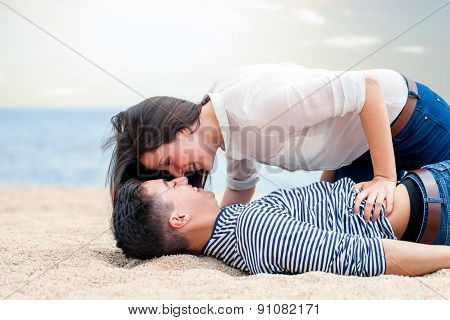 Teen Couple On Beach.