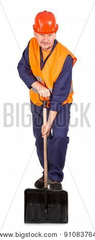Worker holding black shovel.