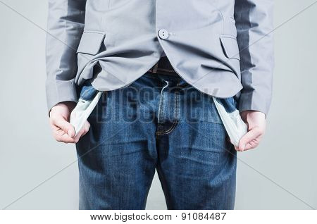 Close up shot of man holding out his empty pockets