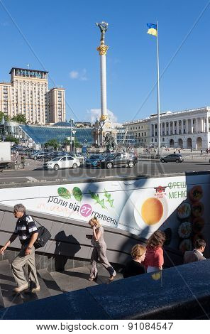 Ukraine, Kiev - May 27,2013: Everyday Life On The Background Of The State Symbols. Underpass On Inde