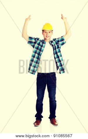 Happy worker presenting empty banner ad.