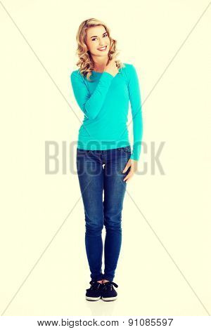 Attractive woman pointing on copy space.