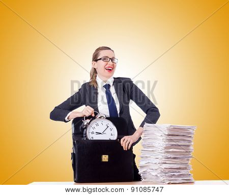 Woman businesswoman with clock and papers