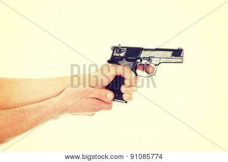 Man holding handgun and aiming