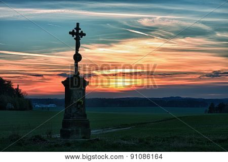 Old cross in sunset in hdr photography