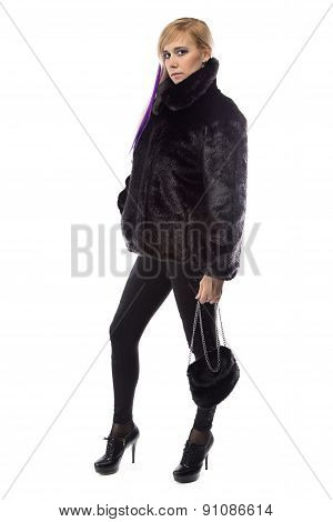 Photo of woman in short fur coat with handbag
