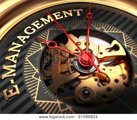 E-Management on Black-Golden Watch Face.