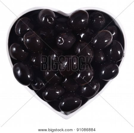 Black Olives In Plate In The Form Of Heart On A White