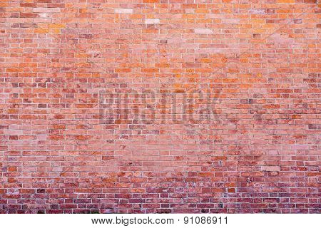 Old Stone Wall From A Natural Brick Of Red Color