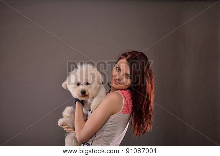 Teenage Girl Holding Maltese Puppy