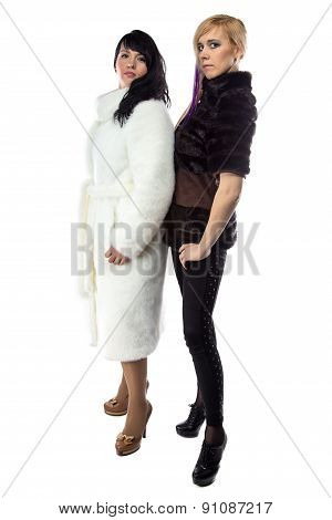 Image of women in fake fur coats