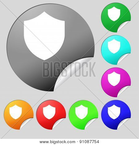 Shield, Protection  Icon Sign. Set Of Eight Multi-colored Round Buttons, Stickers. Vector