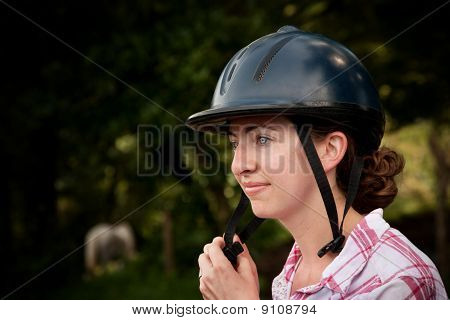 Costa Rican Tourist Putting On Equestrian Helmet
