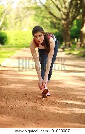 Sportive Girl Exercising Outdoor In Summer Park Before A Run, Training Outdoors