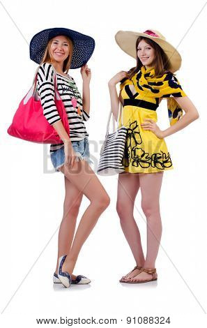 Girls in summer clothing with bags isolated on white