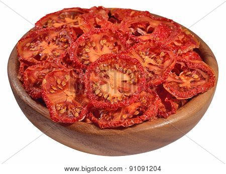 Dried Tomatoes In A Wooden Bowl On A White