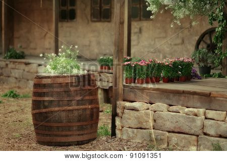 Flowers In A Wooden Barrel