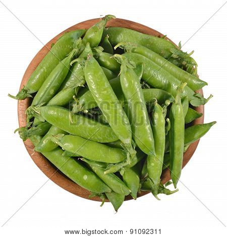 Fresh Green Pea Pods In A Wooden Bowl On A White