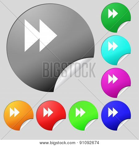 Rewind  Icon Sign. Set Of Eight Multi-colored Round Buttons, Stickers. Vector