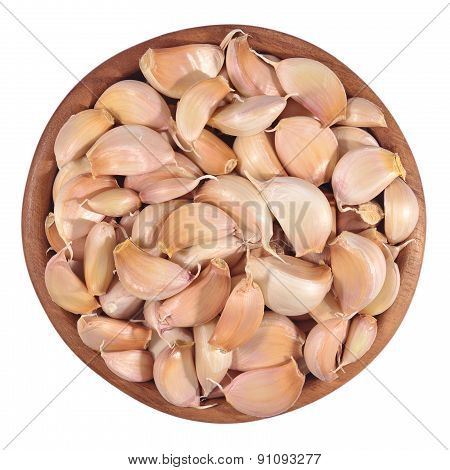 Garlic Cloves In A Wooden Bowl On A White