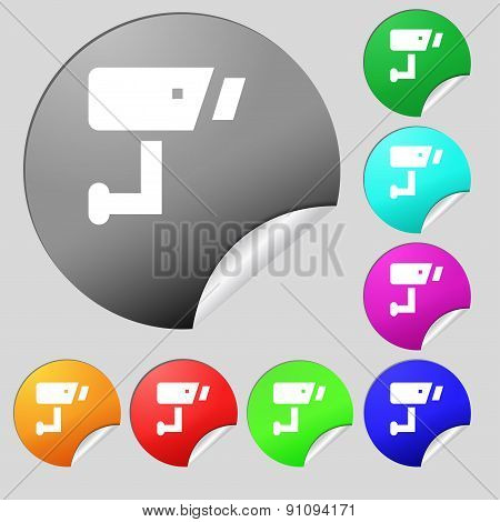 Surveillance Camera  Icon Sign. Set Of Eight Multi-colored Round Buttons, Stickers. Vector