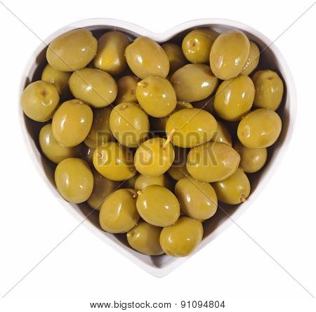 Green Olives In Plate In The Form Of Heart On A White