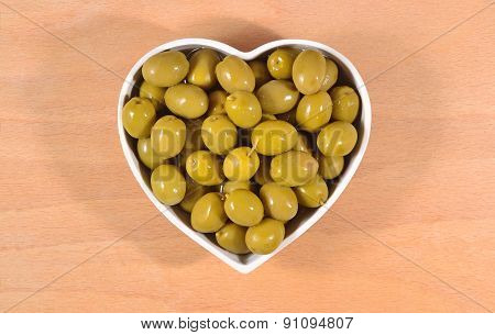 Green Olives In Plate In Form Of Heart
