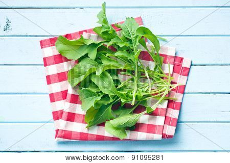 top view of fresh arugula leaves on kitchen table