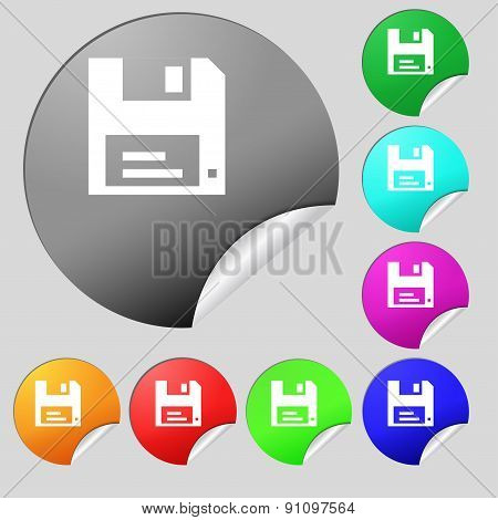 Floppy Icon Sign. Set Of Eight Multi-colored Round Buttons, Stickers. Vector