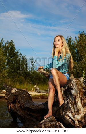Blonde Posing Near Flotsam