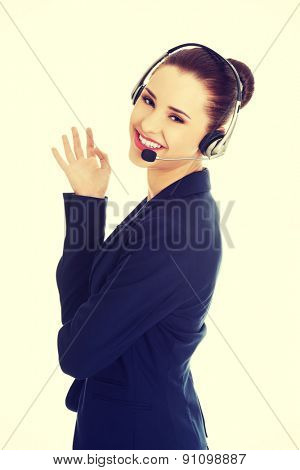 Call center woman with headset gesturing perfect.