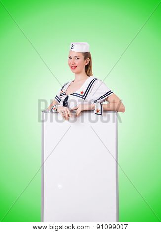 Woman sailor with blank board on white