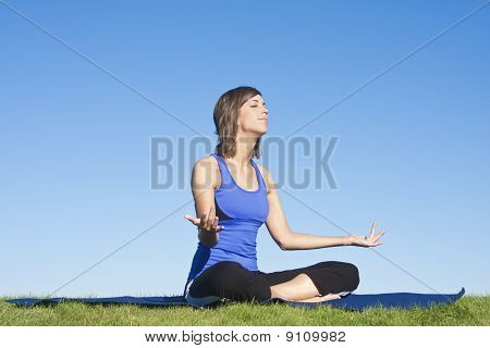 Fitness woman doing Yoga