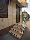 image of distort  - The facade of an apartment house with a porch and the door with wide angle fisheye lens and distortion view - JPG
