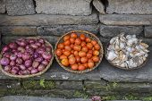 stock photo of red shallot  - closed up the basket of shallot garlic and tomato - JPG