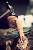 pic of copper  - Copper master hands detail of craftsman at work - JPG