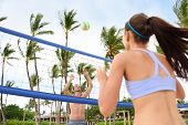 stock photo of beach-ball  - People playing beach volleyball having fun in sporty active lifestyle - JPG