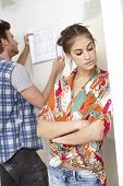 stock photo of sulky  - Young couple planning new home - JPG