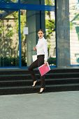 image of shiting  - Stylish business woman in the city street - JPG
