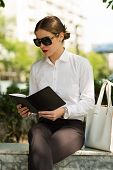 picture of shiting  - Stylish business woman in the city street - JPG