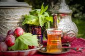 foto of oasis  - Oasis dream with mint tea and red grapes - JPG