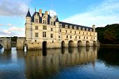 pic of chateau  - The grand Chateau de Chenonceau with reflection in the Cher River Loire Valley France - JPG