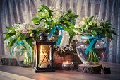 stock photo of three life  - Still life with three wedding bouquets and candles vintage stylized - JPG